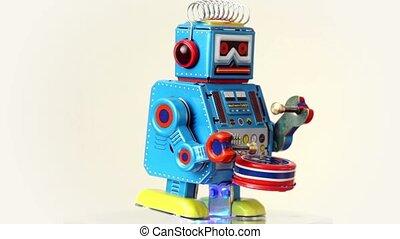 Clockwork robot walks on table, beats drum