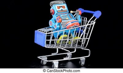 clockwork toy robot with drum sitting in shopping trolley