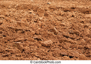 Clods of earth fresh plowing in autumn sunny day