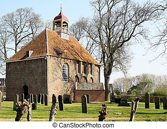 Cloister Church and cemetery from 1250 in the village Thesinge. The Netherlands