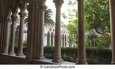 Cloister with beautiful arches and columns in old Dominican...
