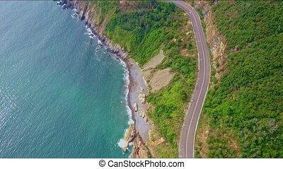 Close Aerial View of Coast Highway along Azure Ocean - close...