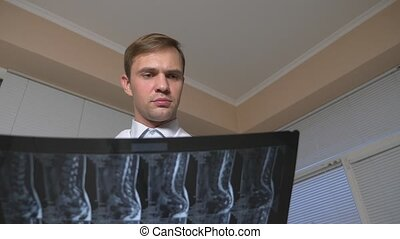 Close . MRI , x-ray images. the doctor analyzes the results...