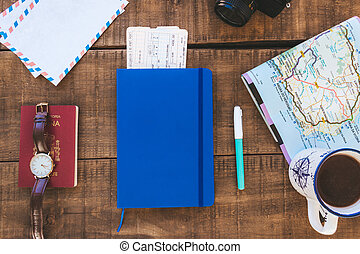 close notebook on a table to plan a trip and write down ...