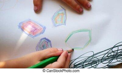Close of kid drawing. Children's creativity