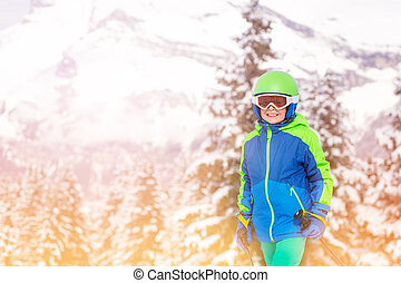 Close portrait of a boy over snow covered forest
