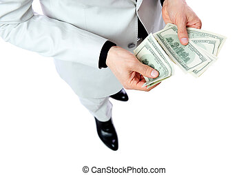 Close portrait of a male hands holding US dollars