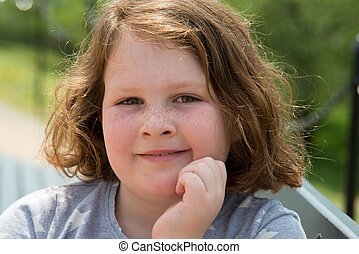 Close Portrait of Happy Young Girl Outside