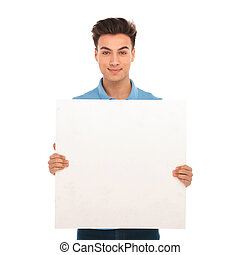 young man holding a blank board