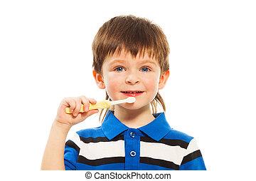 Close shoot of boy brush his teeth