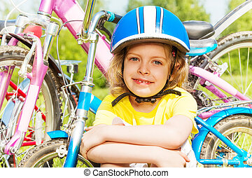 Close shot of a girl in blue bicycle helmet