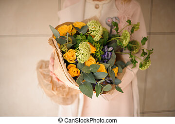 Close shot of bouquet of various flowers