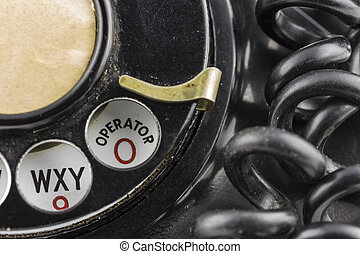 Dial 0 - Close shot of old fashioned rotary phone dialer. ...