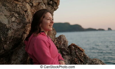 close shot of woman face on shore of lake, looking on landscape