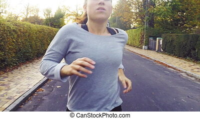 Close Shot of Woman Running - Young fitness woman having an...