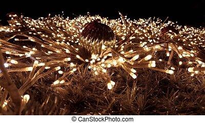 Close shot on a gold tinsel Christmas tree - Christmas tree...