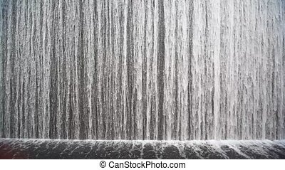 close shot on artificial waterfall indoor - close shot on...