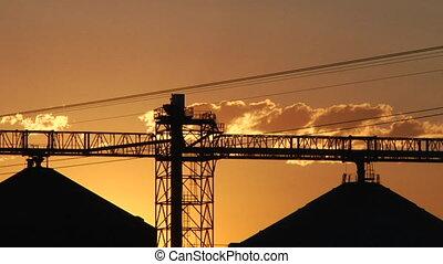 close time lapse silhouette of grain elevators