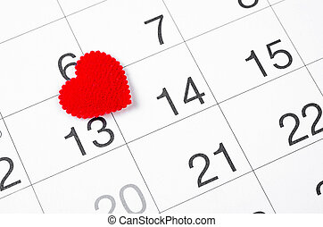 Close up 14th february date 2019 and red heart for reminder.