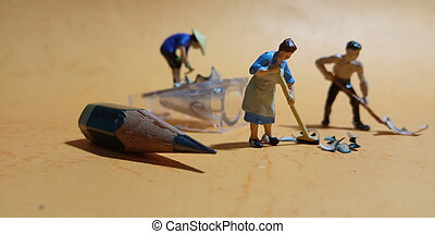 2 man and 1 woman cleaning trash from pencil sharpener with negative space