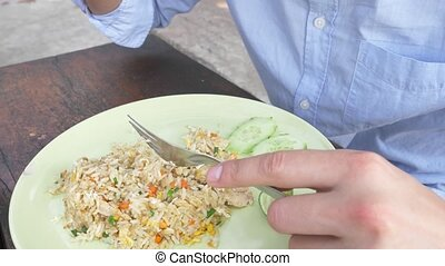 close-up. 4k. man squeezes lime juice on a dish with stir...