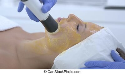 Close-up 4K video of adult woman enjoying beauty treatment in professional salon