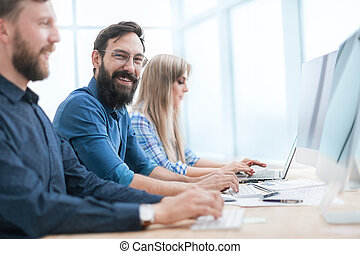 group of business people working in the office together