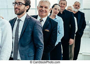 close up. a group of company specialists standing in a row
