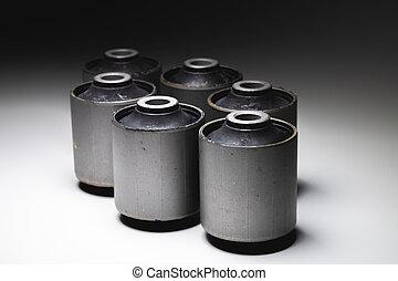 Close-up. A group of cylindrical silent blocks for the rear suspension of an off-road vehicle. Contrast light low key