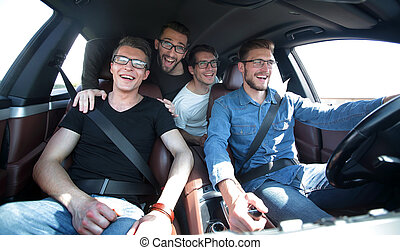 close up. a group of friends traveling in a car