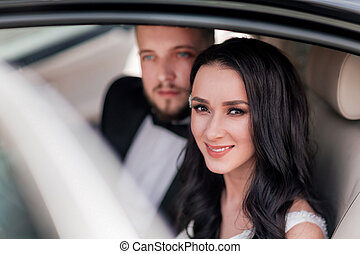 close up. a happy couple of newlyweds sitting in the car.