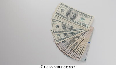 Close-up, a man gets money. He considers dollar bills