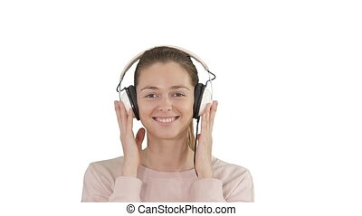A young woman listening to music in headphones on white background.