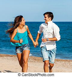 Handsome teen couple running