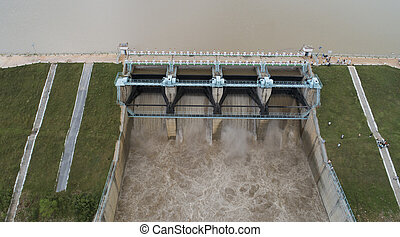 Close up Aerial bird eye of water reservoir flood gates open to release water from dam at raichur, India