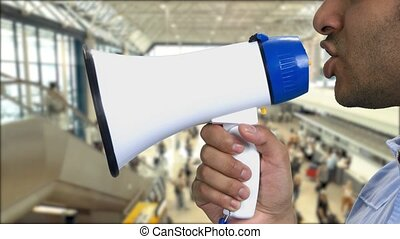 Close up african-american man talking into megaphone.