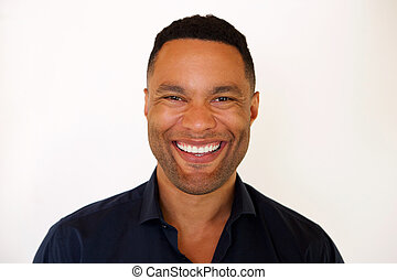 Close up african american young man smiling against white background