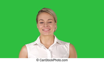 Amazing glamorous luxury woman smiling and walking to camera on a Green Screen, Chroma Key.