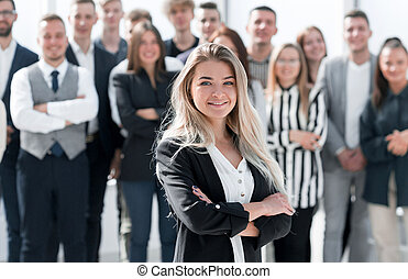 ambitious young business woman standing in front of her colleagues
