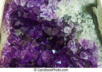 Close up Amethyst crystal, semiprecious gem, on white background