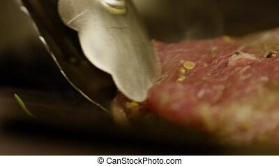 Cook Frying Piece Of Freshly Smelled Steak - Close-up - An...