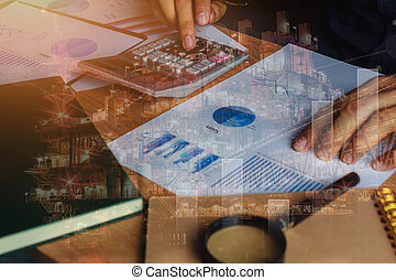 close up asian man calculate banking finance or saving economy background. Double exposure industrial offshore oil and gas platform for cost and growth up business on table office desk with accessories