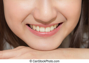 close-up Asian woman smiling with white teeth