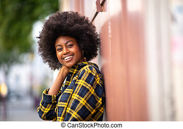 Close up attractive african american smiling woman with afro outside