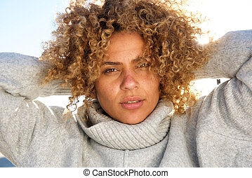 Close up attractive african american woman with hands behind head