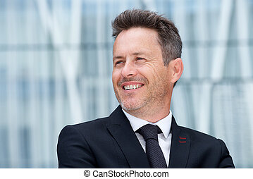 Close up attractive businessman smiling in suit and tie