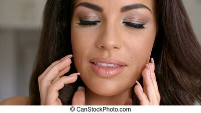Close up Attractive Woman Face with Two Hands