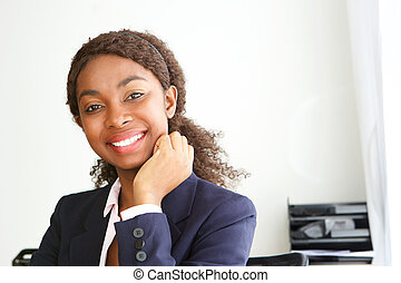 Close up attractive young african businesswoman smiling in office