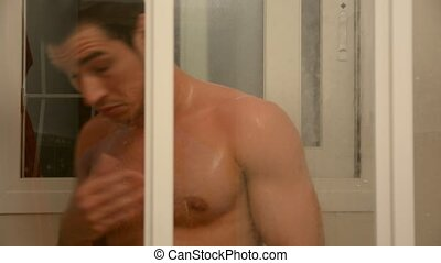 Muscular Young Man Taking Shower - Close up Attractive Young...
