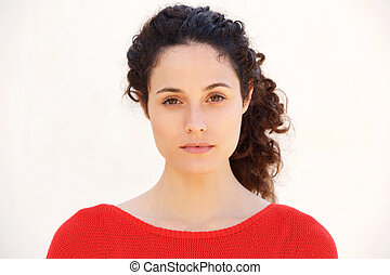 Close up attractive young woman against white background